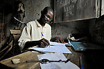 Joseph Nkongdo does his homework in his room in the Congolese village of Wembo Nyama, where he is a first year student at the United Methodist graduate theological school.