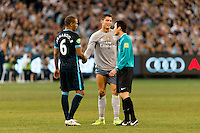 Melbourne, 24 July 2015 - Fernando of Manchester City and Cristiano Ronaldo of Real Madrid shake hands after Fernando fouled Ronaldo in game three of the International Champions Cup match between Manchester City and Real Madrid at the Melbourne Cricket Ground, Australia. Real Madrid def City 4-1. (Photo Sydney Low / AsteriskImages.com)