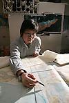 Ron Harris earthquake predicition.GPS receiver, Earth movement model, maps.Professor Ron Harris-white shirt.Laura C. Wald-(purple top) Grad student from Nevada.Hendro Nugroho Grad student from Yogyakarta, Java, Indonesia.Nova Roosmawati-Grad sutdent from Yogyakarta, Java, Indonesia.2/1/05.Photography by Mark A. Philbrick