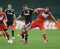 Washington D.C. - April 26, 2014: Adam Moffat (6) of FC Dallas goes against Perry Kitchen (23) of D.C. United.  D.C. United defeated the FC Dallas 4-1 during a Major League Soccer match for the 2014 season at RFK Stadium.