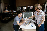 Detroit. U.S.A, September, 1980. America severely marked by the recession. The first to be affected are workers on the bread line and elderly persons without means. The gold purchasers seek for sellers. Here, they are operating in a bakery.