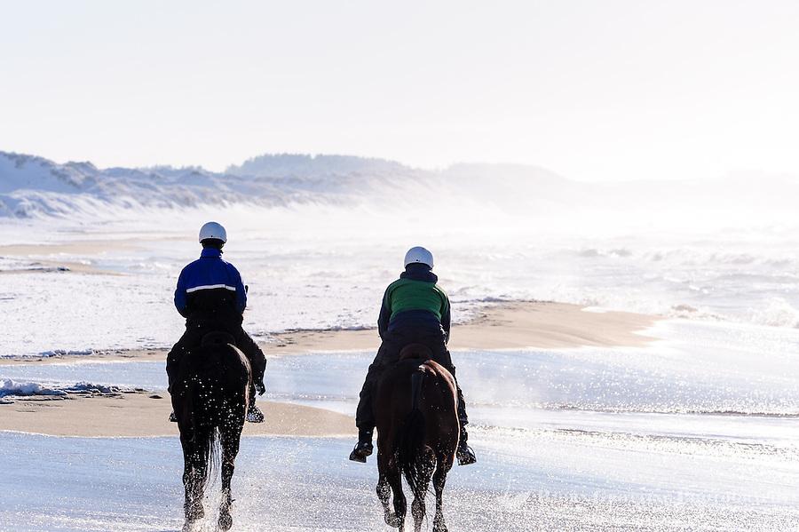Norway, Klepp. Horse riders on Borestrand.