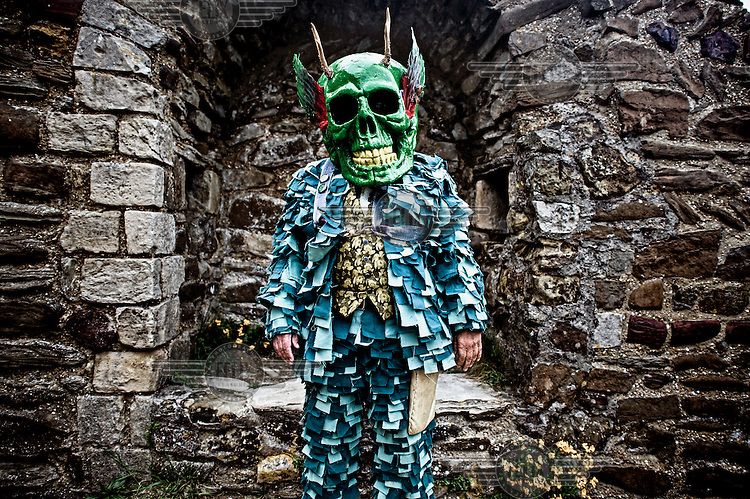 A participant at a Jack in the Green festival. The festival is part of a recent revival of an older custom where people would wear frameworks covering much of their bodies which were decked out in foliage. The custom is connected to English May Day parades that herald  the coming of summer.