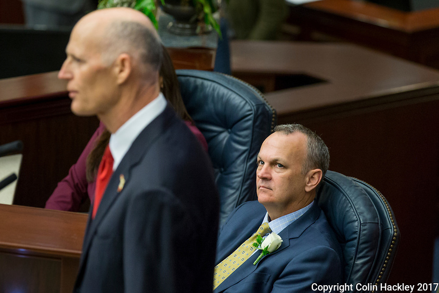 TALLAHASSEE, FLA. 3/7/17-House Speaker  Richard Corcoran, R-Land O'Lakes,right listens to Gov. Rick Scott give his State of the State Speech during the opening day of the 2017 legislative session at the Capitol in Tallahassee.<br /> <br /> COLIN HACKLEY PHOTO