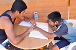 Eleven-year old Juan Lopez studies Braille with Mariano Enriquez at Piña Palmera, a center for community based rehabilitation in Zipolite, a town in Oaxaca, Mexico.