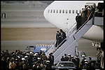 The Ayatollah Khomeini disembarks from an Air France 747 jet at Mehrabad Airport. Tehran, February 1, 1979.