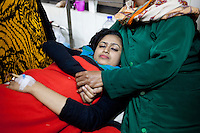 Shathii Akhtar, 19, center, a Bangladeshi student of Eden Mohila College, cries in pain as she receives treatment at a medical college hospital after being injured in a recent bomb attack during the ongoing nationwide blockade called by the opposition Bangladesh Nationalist Party (BNP), in Dhaka, Bangladesh, Sunday, Jan. 18, 2015.