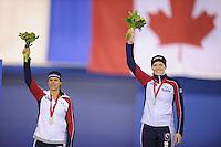 SPEEDSKATING: CALGARY: 14-11-2015, Olympic Oval, ISU World Cup, Podium 1000m Ladies, Brittany Bowe (USA), winner Heather Richardson (USA), ©foto Martin de Jong
