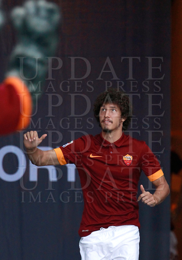 Calcio, amichevole Roma vs Fenerbahce. Roma, stadio Olimpico, 19 agosto 2014.<br /> Roma midfielder Salih Ucan, of Turkey, arrives for the team's presentation, prior to the friendly match between AS Roma and Fenerbahce at Rome's Olympic stadium, 19 August 2014.<br /> UPDATE IMAGES PRESS/Isabella Bonotto