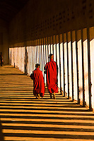Two novice monks walking down a corridor in the Shwezigon Pagoda, Bagan (Pagan), Burma (Myanmar)