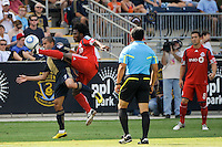Julian de Guzman (6) of Toronto FC and Fred (7) of the Philadelphia Union battle for the ball. The Philadelphia Union defeated Toronto FC 2-1 on a second half stoppage time goal during a Major League Soccer (MLS) match at PPL Park in Chester, PA, on July 17, 2010.