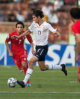William Packwood dribbles the ball. US Under-17 Men's National Team defeated United Arab Emirates 1-0 at Gateway International  Stadium in Ijebu-Ode, Nigeria on November 1, 2009.
