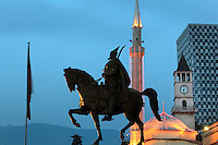 Bronze equestrian statue of George Kastrioti Skanderbeg, a 15th century Albanian nobleman, in the centre of Skanderbeg Square or Sheshi Skenderbej in Tirana, Albania. The statue is by Odhise Paskali, Andrea Mano and Janaq Paco and was inaugurated in 1968, on the 500th anniversary of his death. Behind are the Et'hem Bey Mosque and the clock tower. Tirana was founded by the Ottomans in 1614 by Sulejman Bargjini and became the capital of Albania in 1920. Picture by Manuel Cohen