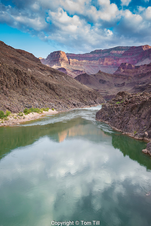 Morning clouds reflected in the Colorado River, Grand Canyon National Park, Arizona, Powell PLateau beyond