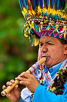 """A Colombian Kamentsá shaman, wearing a colorful feather headgear, plays flute during the Carnival of Forgiveness, a traditional indigenous celebration in Sibundoy, Colombia, 12 February 2013. Clestrinye (""""Carnaval del Perdón"""") is a ritual ceremony kept for centuries in the Valley of Sibundoy in Putumayo (the Amazonian department of Colombia), a home to two closely allied indigenous groups, the Inga and Kamentsá. Although the festival has indigenous origins, the Catholic religion elements have been introduced and merged with the shamanistic tradition. Celebrating annually the collaboration, peace and unity between tribes, they believe that anyone who offended anyone may ask for forgiveness this day and all of them should grant pardons."""