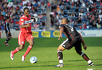 Chicago Fire forward Patrick Nyarko (14) prepares to challenge DC United defender Julius Jones (2).  The Chicago Fire tied DC United 0-0 at Toyota Park in Bridgeview, IL on Oct. 16, 2010.