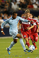 Teal Bunbury (blue) Sporting KC, Logan Pause Chicago Fire...Sporting KC were held to a scoreless tie with Chicago Fire in the inauguarl game at LIVESTRONG Sporting Park, Kansas City, Kansas.