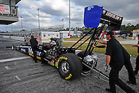 Jan. 17, 2012; Jupiter, FL, USA: Crew members push the car of NHRA top fuel dragster driver Brandon Bernstein during testing at the PRO Winter Warmup at Palm Beach International Raceway. Mandatory Credit: Mark J. Rebilas-