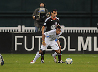 San Jose Earthquakes forward Scott Sealy (9) while cover from behind by DC United defender Jed Zayner (12)  San Jose Earthquakes defeated DC United 2-0 at RFK Stadium, October 9, 2010.