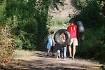 A family heading to the river for a day of tubing on the Blackfoot near Missoula, Montana
