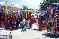Tourists shopping at the handicrafts market in Poncho Plaza, Otavalo, Ecuador