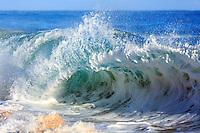 Looking into a blue wave at Secrets (or Secret) Beach, Kaua'i.