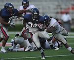 Ole Miss running back Brandon Bolden (34) is tackled by Keith Lewis during a team scrimmage at Vaught-Hemingway Stadium in Oxford, Miss. on Saturday, August 20, 2011.