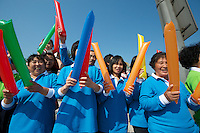 Locals were given matching outfits and other swag at the 2011 Tour of Beijing Stage 2