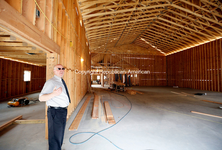 Bethlehem, CT- 06 May 2015-050615CM02- Dan Murray, CEO of Wellspring and the Arch Bridge School, shows off the new gymnasium area, which is under construction in Bethlehem on Wednesday.   Christopher Massa Republican-American