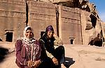 Jordan, Petra. Bedouin women in front of Nabatean tombs&amp;#xA;<br />
