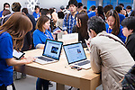 People at Apple Genius Bar technical support centre of a retail store in Ginza, Tokyo, Japan 2014
