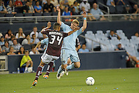 Sporting forward Jacob Peterson (37) is abruptly stopped by Rapids defender Tyrone Marshall. .Sporting Kansas City defeated Colorado Rapids 2-0 in Open Cup play at LIVESTRONG Sporting Park, Kansas City, Kansas.