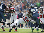 Atlanta Falcons linebacker Sean Weatherspoon dives for Seattle Seahawks running back Marshawn Lynch at CenturyLink Field in Seattle, Washington on October 2, 2011. The Falcons beat the Seahawks 30-28 . ©2011 Jim Bryant Photo. All Rights Reserved.
