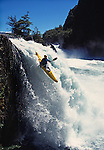 The late American expeditionary kayaker Lars Holbek going over the falls on the Petrohue River in the southern mountains of Chile.