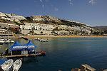 Hotels overlooking harbour, boats and beach at Puerto Rico, Gran Canaria, Canary Islands, Spain.