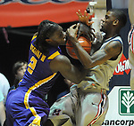 "LSU's Johnny O'Bryant III (2) and Mississippi's Terrance Henry (1) fight for the ball at the C.M. ""Tad"" Smith Coliseum in Oxford, Miss. on Saturday, February 25, 2012. (AP Photo/Oxford Eagle, Bruce Newman).."