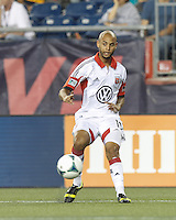 D.C. United midfielder Kyle Porter (19) crosses the ball.  In a Major League Soccer (MLS) match, the New England Revolution (blue) tied D.C. United (white), 0-0, at Gillette Stadium on June 8, 2013.