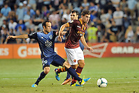 Sporting Park, Kansas City, Kansas, July 31 2013:<br /> Kevin Strootman (6) midfield AS Roma holds off the challenge from Landon Donovan.<br /> MLS All-Stars were defeated 3-1 by AS Roma at Sporting Park, Kansas City, KS in the 2013 AT &amp; T All-Star game.