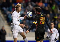 Jake Pace (20) of Maryland goes up for a header with Grant Van De Castelle (20) of Notre Dame  during the NCAA Men's College Cup final at PPL Park in Chester, PA.  Notre Dame defeated Maryland, 2-1.