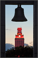 From a group of hanging bells, this is a photo of the UT Tower as it turns orange at dusk. This tower on the University of Texas campus is an icon of the Austin area.