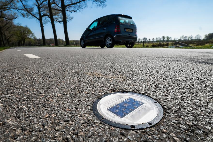 Nederland, omgev. Boekel, 20 april 2015<br /> Wegverlichting in het asfalt met zonnecel voor electriciteit. <br /> <br /> Foto: Michiel Wijnbergh