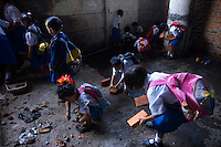Young children help carry bricks and stones to the new site of the Kartini Emergency School. In September 2007 city authorities evicted the school from its location under a North Jakarta highway. Undaunted, students and the 'Twin Teachers' moved the school piece by piece to its new temporary home. Since the early 1990s, twin sisters Sri Rosyati (known as Rossy) and Sri Irianingsih (known as Rian) have used their family inheritance to set up and run 64 schools in different parts of Indonesia, providing primary education combined with practical skills to some of the country's most deprived children.