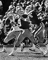 San Francisco 49er quarterback Jeff Kemp , Bubba Parris protects. (1986 photo by Ron Riesterer)