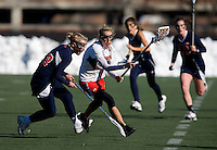 Sarah Mollison (1) of Maryland takes the pass and sprints past Alexis Brenna (23) of Richmond at the practice turf field in College Park, Maryland.  Maryland defeated Richmond, 17-7.