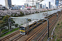 April 7, 2012, Tokyo, Japan - A train runs by the Imperial moat lined with fully-bloomed cherry blossoms in the heart of Tokyo on Saturday, April 7, 2012...Its Easter weekend for Christians but its a cherry blossoms viewing time for Japanese. The annual cherry blossoms blooms is a national obsession in the country and specially this years Hanami was keenly awaited because of the harsh winter and after a disastrous year of March 11 earthquake and tsunami in the nations northeastern region. (Photo by Natsuki Sakai/AFLO) AYF -mis-.