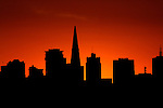 The San Francisco skyline was silhouetted by the sunrise.