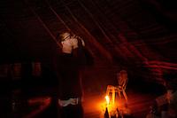 Iquitos, Peru, September 13, 2013 - Writer Alard Kittlitz drinking the ayahuasca.