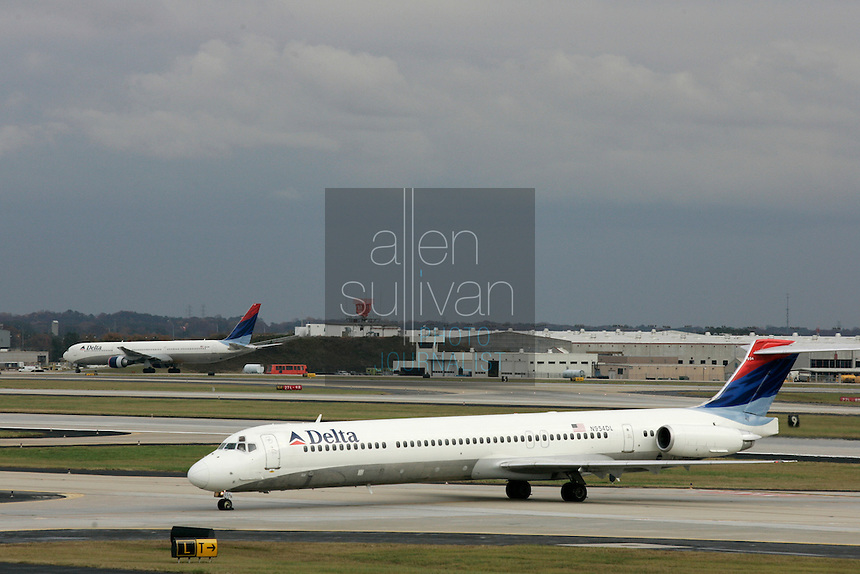 Delta Air Lines planes on the tarmac at Hartsfield-Jackson Atlanta International Airport. US Airways has made a bid to take over Delta Air Lines, which is headquartered in Atlanta.<br />