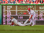 22 May 2015: Philadelphia Phillies first baseman Ryan Howard slides safely into second with a double in the second inning, ahead of the attempted tag by Washington Nationals infielder Yunel Escobar during a game at Nationals Park in Washington, DC. The Nationals defeated the Phillies 2-1 in the first game of their 3-game weekend series. Mandatory Credit: Ed Wolfstein Photo *** RAW (NEF) Image File Available ***
