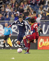 Real Salt Lake forward Fabian Espindola (7) attempts to control the ball as New England Revolution midfielder Chris Tierney (8) closes. Real Salt Lake defeated the New England Revolution, 2-1, at Gillette Stadium on October 2, 2010.